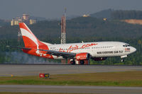 9M-AAX @ WMKK - Air Asia 737-300 - by Andy Graf-VAP