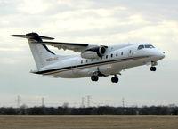 N328AC @ GKY - Dornier 328  -  Takeoff!