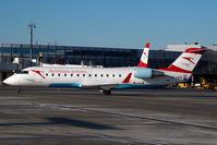 OE-LCQ @ VIE - Austrian Arrows Regionaljet - by Yakfreak - VAP