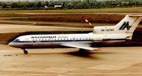 RA-42389 @ EDDL - Macedonia  Yak42 at Dusseldorf in 1995