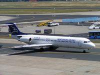 YU-AOM @ EDDF - Montenegro Airlines Fokker 100 taxies for departure at Frankfurt in 2004