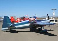 N540WS @ KIC - Bill Stein Aerosports (Team Oracle) 2002 Zivko Aeronautics Inc EDGE 540 strapping-in @ Mesa del Rey (King City) Airport, CA - by Steve Nation