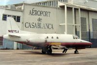N107CJ @ OPF - Despite the background titles (used for a Film set) - this photograph was taken at Opa Locka in 1992 - by Terry Fletcher