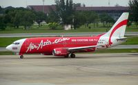 HS-AAJ @ VTBD - Air Asia B737 taxies out at Bangkok Don Muang , the only airport I know of that has a golf course seperating the two runways !!