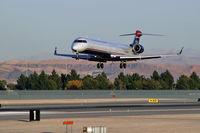 N910FJ @ KLAS - US Airways Express / 2003 Bombardier Inc CL600-2D24