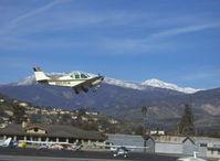 N8645M @ SZP - 1963 Beech 35-B33 DEBONAIR, Continental IO-470-K 225 Hp, takeoff climb Rwy 04, gear coming up - by Doug Robertson