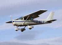 G-BGLG @ EGCF - Cessna 152 landing on a very windy day at Sandtoft