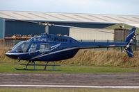 G-OJPS @ EGCF - Bell 206B at Sandtoft in Feb 2008