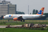 EI-DOE @ LFPG - Windjet's A320 taxies from the Charter Terminal for a southern departure from Paris CDG