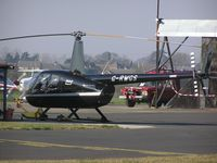 G-RWGS @ EGSF - Robinson R44 Raven II at Conington - by Simon Palmer