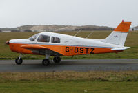 G-BSTZ @ EGNH - This Piper wear the Tangerine and White Colours of the local Soccer Team