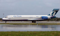 N954AT @ FLL - Air Tran awaits departure from a very wet FLL