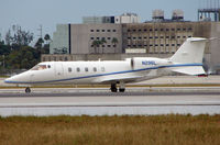 N296L @ MIA - Learjet 60 taxies in after landing at Miami in Feb 2008