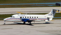 N218YV @ FLL - Gulfstream International B1900D taxies off stand at Ft Lauderdale Int