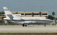 N127SF @ MIA - Falcon 900EX about to depart Miami in the mid-afternoon heat