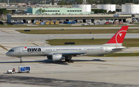 N511US @ FLL - Northwest B757 taxies out for departure from FLL