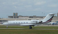 N495QS @ PBI - The business aircraft traffic at West Palm Beach on the Friday before President's Day always provides the aviation enthusiast / photographer with a treat