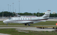 N690QS @ PBI - The business aircraft traffic at West Palm Beach on the Friday before President's Day always provides the aviation enthusiast / photographer with a treat