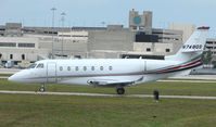 N748QS @ PBI - The business aircraft traffic at West Palm Beach on the Friday before President's Day always provides the aviation enthusiast / photographer with a treat