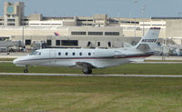 N610QS @ PBI - The business aircraft traffic at West Palm Beach on the Friday before President's Day always provides the aviation enthusiast / photographer with a treat