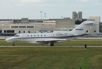 N999QS @ PBI - The business aircraft traffic at West Palm Beach on the Friday before President's Day always provides the aviation enthusiast / photographer with a treat