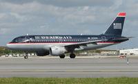 N754UW @ FLL - US Air A319 prepares to depart FLL