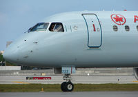 C-FMZD @ FLL - The pilot of this Air Canada EMB190 looks a bit bemused by all the attention from the photographers
