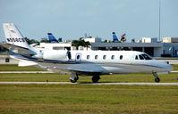 N556CS @ PBI - Citation 560 Excel taxies in at West Palm Beach