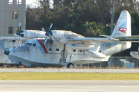 N16CA @ EVB - This Grumman HU-16A appears to show its age , stuck in the SE corner of New Smyrna Beach airport