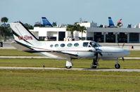 N75HW @ PBI - Cessna 425 taxies in at West Palm Beach