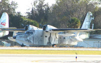 N16ZE @ EVB - This Grumman HU-16E appears to show its age , stuck in the SE corner of New Smyrna Beach airport