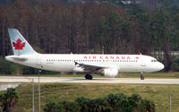 C-FTJS @ MCO - Air Canada A320 taxies over the inter-terminal connecting bridge at Orlando Int
