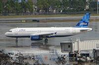 N621JB @ MCO - Jetblue A320 pulls off stand at Orlando Int