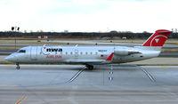 N821AY @ PHL - Northwest CRJ arrives at Philadelphia