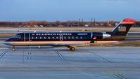 N221PS @ PHL - US Airways CRJ arrives Philadelphia just before dusk