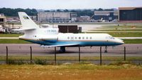 C6-BER @ EGKK - An early Falcon 50 in 1983 on the old Gatwick bizjet ramp - before this whole area was developed as Gatwick North Terminal and Hotel Complex - by Terry Fletcher