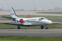 G-VUEZ @ EGCC - Cessna 550 parked on the remote executive ramp at Manchester - by Terry Fletcher