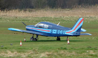 G-BCGI @ EGCB - Piper PA-28-140 parked remotely  at a waterlogged  Barton