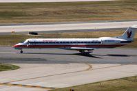 N671AE @ CID - Take-off roll on Runway 13 - by Glenn E. Chatfield