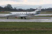 M-BWFC @ EGCC - Taken at Manchester Airport on a typical showery April day - by Steve Staunton
