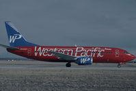 N945WP @ KCOS - Western Pacific Boeing 737-300