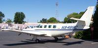 N9488C @ EDU - Cessna T303 - by Reed Maxson