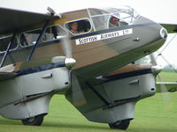 G-AGJG @ EGBK - There looks a wealth of flying experience inside this classic aircraft