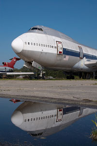 N602PR @ KMEB - ex Northwest Boeing 747 - reflection