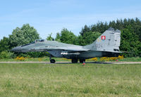 6124 @ EPSN - The Slovak air force held a live firing exercise in Poland. Note the live air to air missiles underneath the wing. - by Joop de Groot