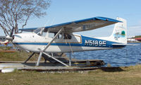 N5189E @ LHD - A Cessna 180B of Skeeter Air sits in the Lake Hood sunshine