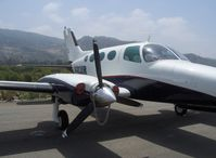 N402DR @ SZP - 1967 Cessna 402, two Continental TSIO-520-VBs 325 Hp each, ex C-FFAP, security chain on prop - by Doug Robertson