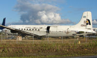 N810CS @ FAI - C-118A  ex 131604 sits in Everts Storage area at Fairbanks Int