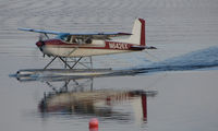 N6426X @ LHD - Cessna 180D forms a mirror image on Lake Hood
