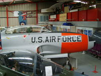 51-4419 @ EGBE - Lockheed T-33A displayed inside the main, but cramped hangar - by chrishall